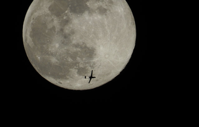 The Turkish Unmanned Aerial Vehicle (IHA), belonging to the Turkish Armed Forces, passes by Supermoon in Idlib, Syria on April 07, 2020. (Photo by Nasir Akil/Anadolu Agency via Getty Images)