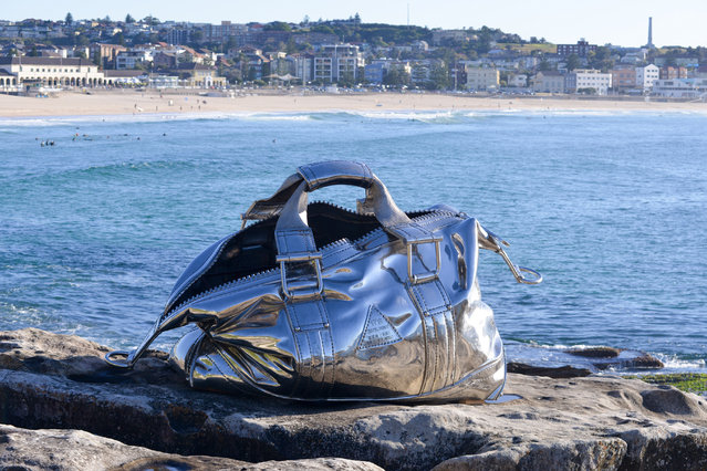 """A sculpture titled """"Travelling Bag"""" is seen at """"Sculpture By The Sea"""" at Bondi Beach on October 20, 2016 in Sydney, Australia. (Photo by Clyde Yee)"""