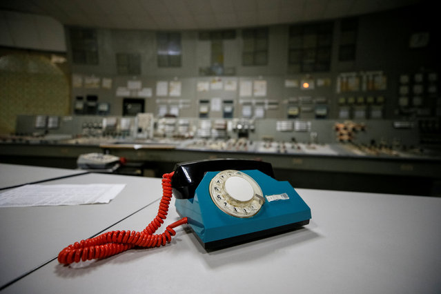 A telephone is seen in a control centre of the stopped third reactor at the Chernobyl nuclear power plant in Chernobyl, Ukraine April 20, 2018. (Photo by Gleb Garanich/Reuters)