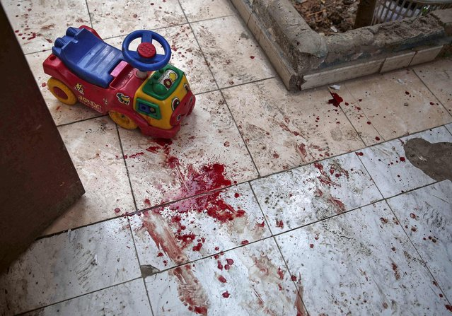 A picture shows the blood stained floor of a kindergarten following reported shelling in the rebel-held area of Harasta, on the northeastern outskirts of the capital Damascus, on November 6, 2016. At least four children were killed and 19 people injured in the government strike in Harasta, according to the Syrian Observatory for Human Rights. (Photo by Sameer Al-Doumy/AFP Photo)