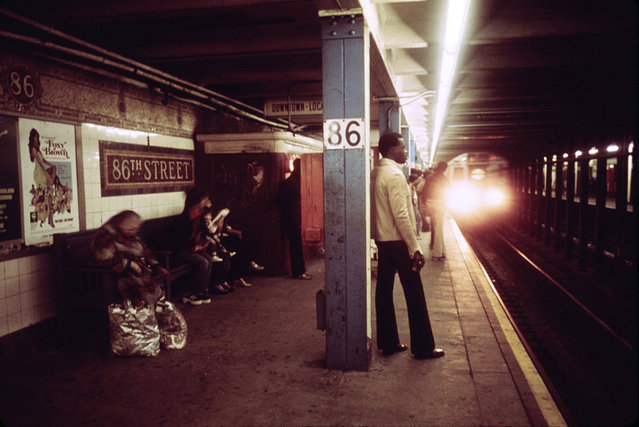 Passengers wait for a Lexington Avenue Line subway train on one of the platforms of the New York City Transit Authority, April, 1974. (Photo by Jim Pickerell/NARA via The Atlantic)