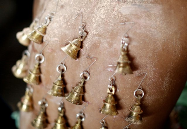 A Hindu devotee pierced with bells is seen before his pilgrimage to the Batu Caves temple during Thaipusam in Kuala Lumpur February 3, 2015. (Photo by Olivia Harris/Reuters)