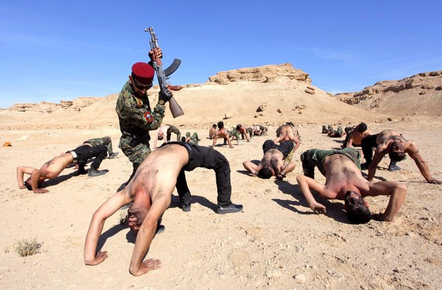 Shi'ite fighters, who have joined the Iraqi army to fight against militants of the Islamic State, take part in field training in the desert in Najaf, south of Baghdad, February 1, 2015. (Photo by Alaa Al-Marjani/Reuters)