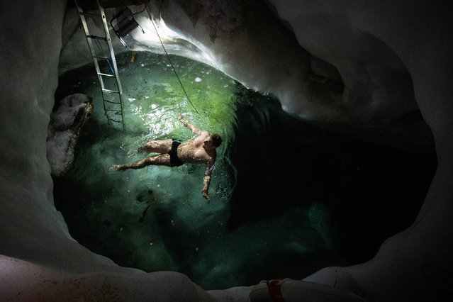 Ice swimmer Rene swims in a filled up water kettle in an ice cave inside the Nature Ice Palace, with a hight of 3,250 meters (10,663 feet) above sea level, at Hintertux Glacier near Hintertux, some 480 kilometers (298 miles) western of Vienna, Austria, 28 July 2018. (Photo by Christian Bruna/EPA/EFE)