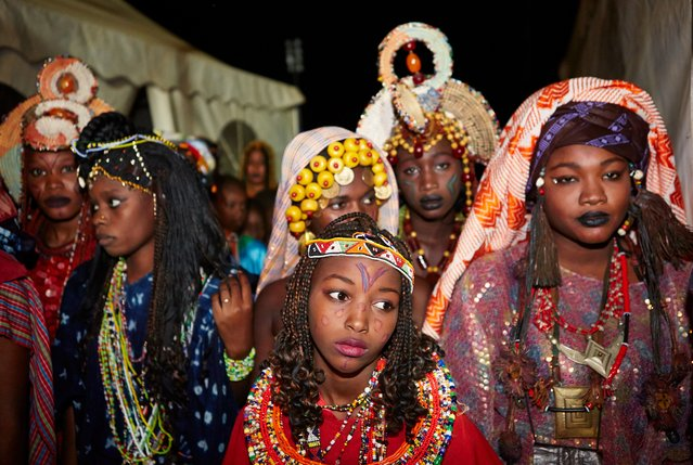 Dancers wait to perform on stage. (Photo by Andy Hall/The Observer)