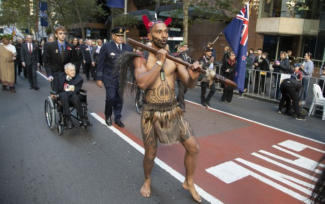 A New Zealand Maori warrior marches during the Anzac Day parade in Sydney, Australia, Sunday, April 25, 2021. (Photo by Mark Baker/AP Photo)