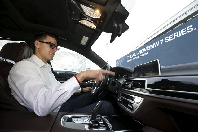 BMW's Vlatko Kalinic demonstrates a gesture control feature to control the radio volume in a 2016 BMW 750i sedan during the 2016 CES trade show in Las Vegas, Nevada January 7, 2016. Germans love the latest wave of touch-free car controls, which respond to the flick of a wrist or the swipe of a hand, as it means no messy fingerprints on their spotless dashboards. Italians, known for an extravagant hand gesture or two, are not so sure.  (Photo by Steve Marcus/Reuters)