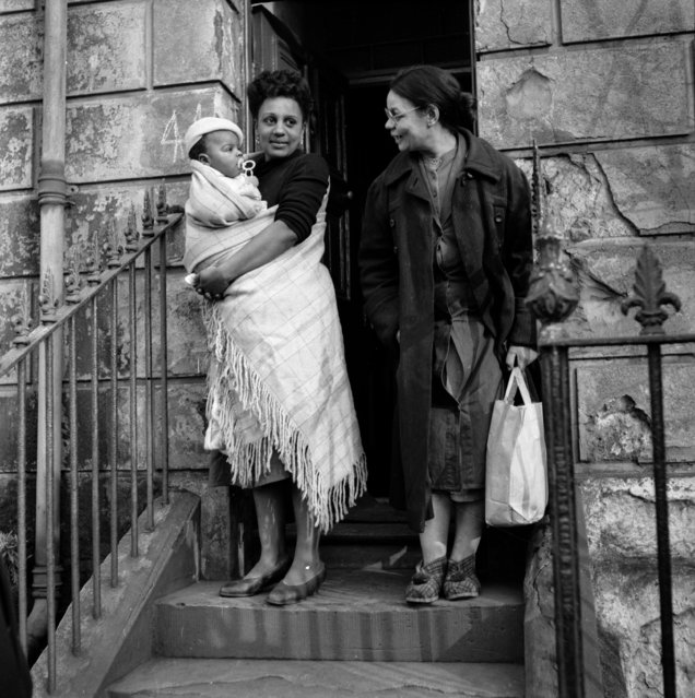 A couple of young women and a baby in Bute Town, one of the poorest areas of Cardiff, 23rd January 1954. The area has a lively ethnic mix of families with Arab, Somali, West African, West Indian, Egyptian, Greek, and many other origins. (Photo by Bert Hardy/Picture Post/Getty Images)