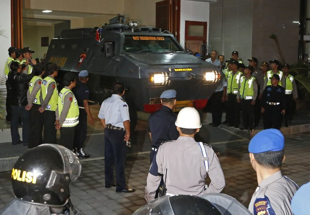 An armoured vehicle believed to be carrying two Australian death row prisoners Myuran Sukumaran and Andrew Chan leaves Kerobokan Prison for the airport, in Denpasar, on the Indonesian island of Bali, March 4, 2015. Two convicted Australian drug smugglers were removed from a prison in Bali on Wednesday to be taken to an Indonesian island where they will be shot by firing squad, Australian media reported