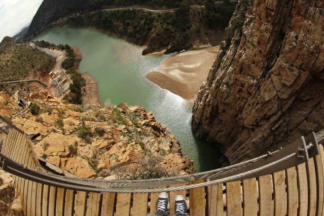 Journalists (L) walk along the new Caminito del Rey (The King's Little Pathway) in El Chorro-Alora, near Malaga, southern Spain March 15, 2015. (Photo by Jon Nazca/Reuters)