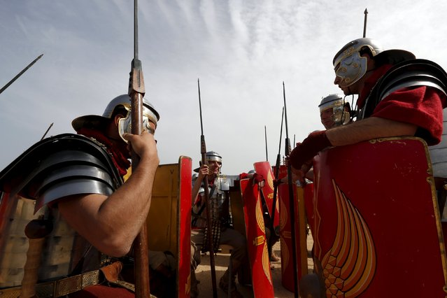 Members of the Legio X Fretensis (Malta) re-enactment group wait to start a display of ancient Roman army life at Fort Rinella in Kalkara, outside Valletta, March 22, 2015. (Photo by Darrin Zammit Lupi/Reuters)
