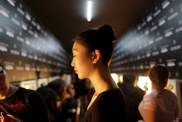 A model waits to apply make-up backstage before the Hempel Award 23rd China International Young Fashion Designers Contest show at China Fashion Week in Beijing, March 25, 2015. (Photo by Jason Lee/Reuters)