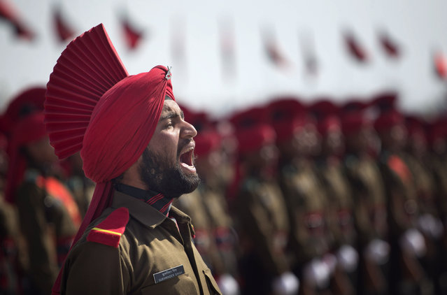 A newly raised soldier of Indian Army Jammu Kashmir Light Infantry Regiment (JKLIR) shouts a command during a commencement parade at a military base on the outskirts of Srinagar, India, Friday, March 27, 2015. 183 recruits from Jammu and Kashmir state were formally inducted into JKLIR after completing their training. (Photo by Dar Yasin/AP Photo)