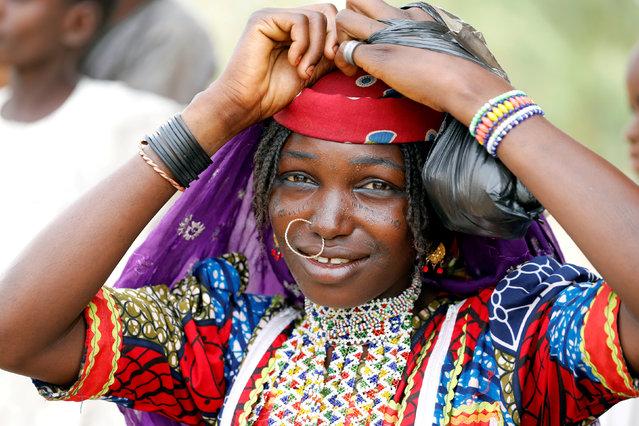 A Fulani woman fixes her head scalf on the street of Dapchi, Yobe state, Nigeria February 27, 2018. (Photo by Afolabi Sotunde/Reuters)