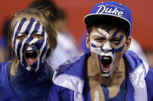 Duke fans cheer before the NCAA Final Four tournament college basketball semifinal game between Duke and Michigan State, Saturday, April 4, 2015, in Indianapolis. (Photo by David J. Phillip/AP Photo)