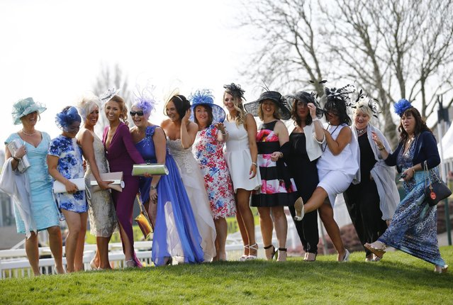 Horse Racing – Crabbie's Grand National Festival – Aintree Racecourse April 10, 2015: Racegoers pose on ladies day during the Grand National. (Photo by Darren Staples/Reuters)