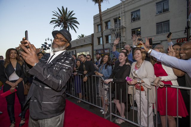 "Cast member Samuel L. Jackson takes a selfie in front of fans at the premiere of ""Avengers: Age of Ultron"" at Dolby theatre in Hollywood, California April 13, 2015. (Photo by Mario Anzuoni/Reuters)"