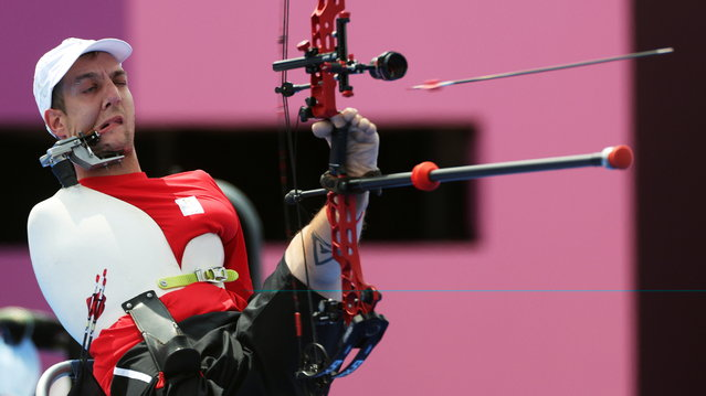 Piotr Van Montagu of Belgium competes in the men's archery individual compound open 1/8 elimination at the Tokyo 2020 Paralympic Games in Tokyo, Japan on August 31, 2021. (Photo by Molly Darlington/Reuters)