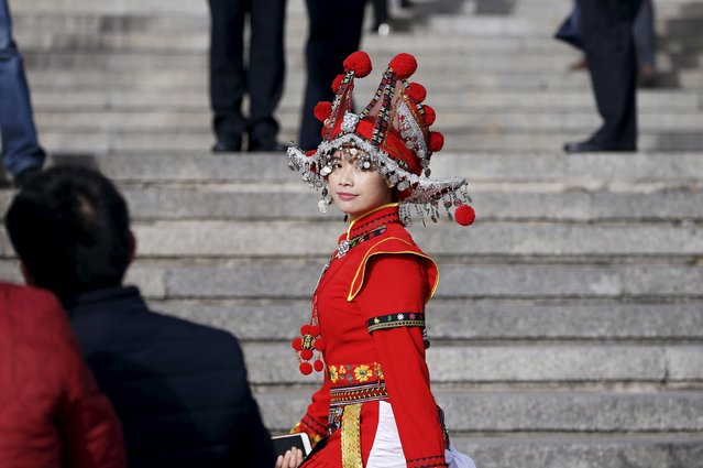 An ethnic minority delegate arrives for the opening session of the National People's Congress (NPC) at the Great Hall of the People in Beijing, China March 5, 2016. (Photo by Aly Song/Reuters)