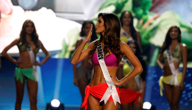 Miss France Iris Mittenaere blows a kiss during the swimsuit competition, shortly before winning the 65th Miss Universe beauty pageant at the Mall of Asia Arena, in Pasay, Metro Manila, Philippines January 30, 2017. (Photo by Erik De Castro/Reuters)