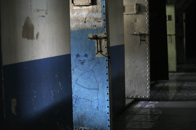This April 7, 2015 photo shows a drawing of Po, the character from the Kung Fu Panda animated film, drawn on the door of a cell inside the now empty Garcia Moreno Prison, during a guided tour for the public in Quito, Ecuador. Now that this former world has been moved to another place, the time will soon come to erase the stories engraved on these walls. (Photo by Dolores Ochoa/AP Photo)