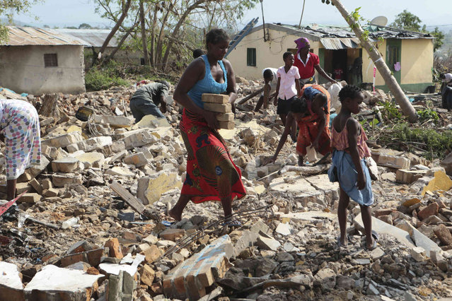 A woman picks up bricks from a collapsed house to build another structure in Beira, Mozambique, Sunday, March, 31, 2019. Cholera cases among cyclone survivors in Mozambique have jumped to 271, authorities said. So far no cholera deaths have been confirmed, the report said. Another Lusa report said the death toll in central Mozambique from the cyclone that hit on March 14 had inched up to 501. Authorities have warned the toll is highly preliminary as flood waters recede and reveal more bodies. (Photo by Tsvangirayi Mukwazhi/AP Photo)