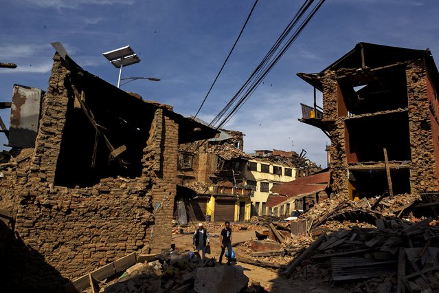 Earthquake survivors walk past their collapsed houses in Sankhu, on the outskirts of Kathmandu, Nepal, May 5, 2015. (Photo by Athit Perawongmetha/Reuters)