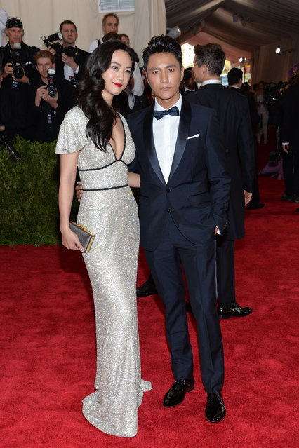 "Tang Wei, left, and Chen Kun arrive at The Metropolitan Museum of Art's Costume Institute benefit gala celebrating ""China: Through the Looking Glass"" on Monday, May 4, 2015, in New York. (Photo by Evan Agostini/Invision/AP Photo)"