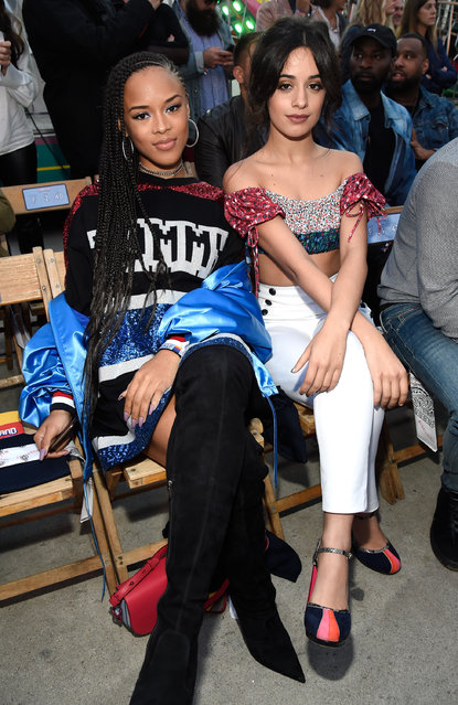 Singer/actress Serayah McNeill (L) and singer Camila Cabello at the TommyLand Tommy Hilfiger Spring 2017 Fashion Show on February 8, 2017 in Venice, California. (Photo by Kevin Mazur/Getty Images)