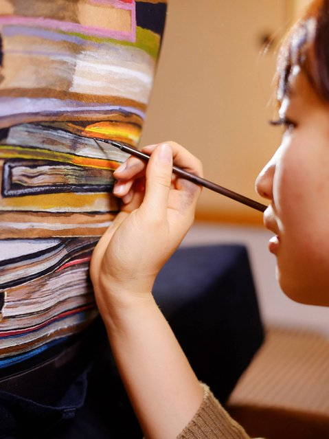 Books are painted on a model's back. (Photo by Jim Marks/PA Wire)