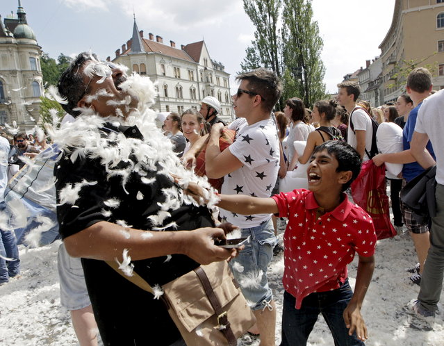 Tourists from India take part in a pillow fight in Ljubljana, Slovenia, May 14, 2015. The pillow fight is part of fundraising efforts for earthquake-affected victims in Nepal organized by a local radio station. (Photo by Srdjan Zivulovic/Reuters)