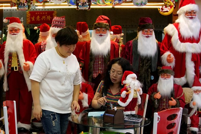 Women talk in a stall that sells Christmas products at the Yiwu Wholesale Market in Yiwu, Zhejiang province, China, May 10, 2019. (Photo by Aly Song/Reuters)