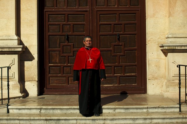 "Benito Carrasco, 57, dressed as a cardinal poses for a photo outside a church as he participates in the third edition of ""Ronda Romantica"" (Romantic Ronda) in Ronda, southern Spain, May 16, 2015. (Photo by Jon Nazca/Reuters)"