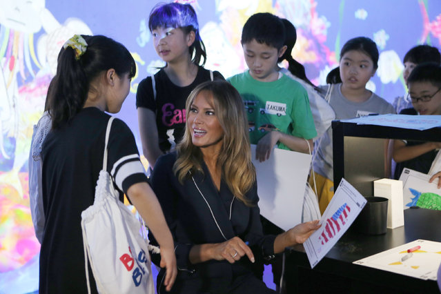 U.S. first lady Melania Trump chats with children as she visits a digital art museum Sunday, May 26, 2019, in Tokyo. (Photo by Koji Sasahara/AP Photo)