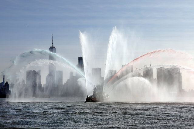 """The Fire Department of New York """"Firefighter II"""" sprays water while participating in Fleet Week New York, in New York harbor, Wednesday, May 22, 2019. (Photo by Richard Drew/AP Photo)"""