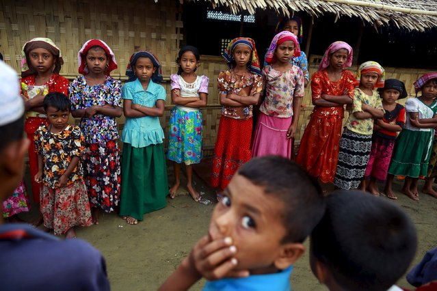 Children attend a class on the Koran conducted by a Rohingya Muslim religious teacher at a refugee camp outside Sittwe, Myanmar May 21, 2015. (Photo by Soe Zeya Tun/Reuters)