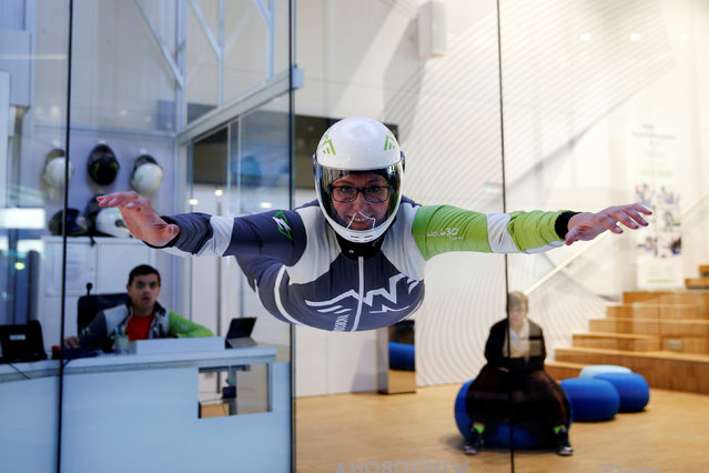 """Paloma Granero, 38, a skydiving instructor, poses for a photograph inside the wind tunnel at Windobona indoor skydiving in Madrid, Spain, February 24, 2017. """"Men don't have to prove themselves like we do. We are tested every day"""", Granero said. """"The instruction jobs still go mostly to men, whereas the administrative jobs go mostly to women"""". (Photo by Susana Vera/Reuters)"""