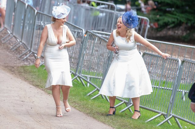 "Race-goers attend day three of Royal Ascot in Ascot, Britain, 20 June 2019. Royal Ascot is Britain's most valuable horse race meeting and social event running daily from 18 to 22 June 2019. Thursday's meeting is more commonly known as ""Ladies Day'"". (Photo by South West News Service)"