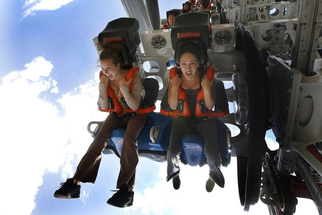 X2 at Six Flags Magic Mountain in Valencia, California features 360-degree rotating seats and an entire sensory explosion of fire, fog and sound elements. (Photo by Caters News)