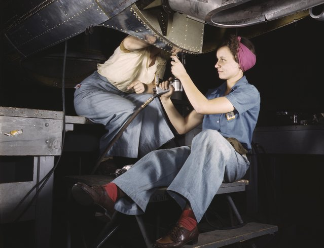Women at work on bomber, Douglas Aircraft Company, Long Beach, California, 1942. (Photo by Alfred T. Palmer/Buyenlarge/Getty Images)