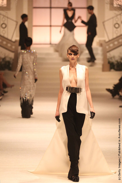 A model showcases designs by Stephane Rolland on the catwalk as part of Women's Fashion Week Haute Couture