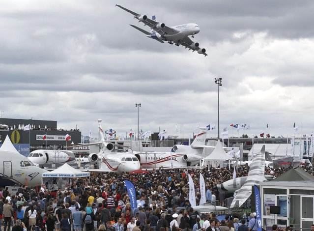 An Airbus 380 prepares to land after its demonstration flight during the closing day of the Paris Air Show in Le Bourget, north of Paris, Sunday,  June 21, 2015. Some 300,000 aviation professionals and spectators are expected at this weekends Paris Air Show, coming from around the world to make business deals and see dramatic displays of aeronautic prowess and the latest air and space technology. (AP Photo/Michel Euler)