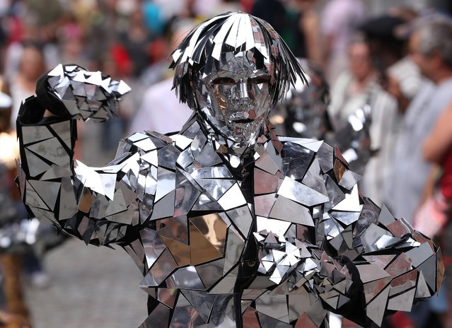 """An artist called """"Mirror Family"""" takes part in the festival """"Statues en Marche"""" in Marche-en-Famenne, Belgium, July 20, 2019. (Photo by Yves Herman/Reuters)"""