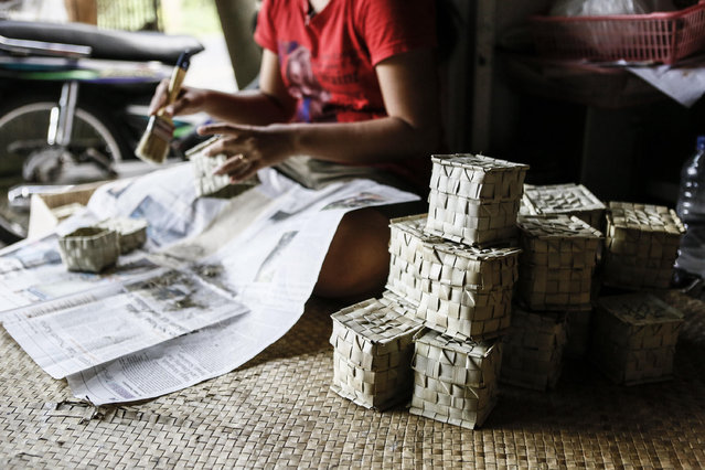 Staff worker prepares the boxes made of woven palm for painted eggs at Wayan Sadra's workshop on April 14, 2014 in Sukawati, Gianyar, Bali, Indonesia. (Photo by Putu Sayoga/Getty Images)