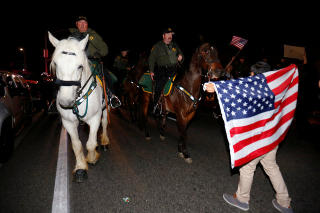 Police on horseback force a demonstrator away from a rally point outside Republican U.S. presidential candidate Donald Trump's campaign rally in Costa Mesa, California April 28, 2016. (Photo by Mike Blake/Reuters)
