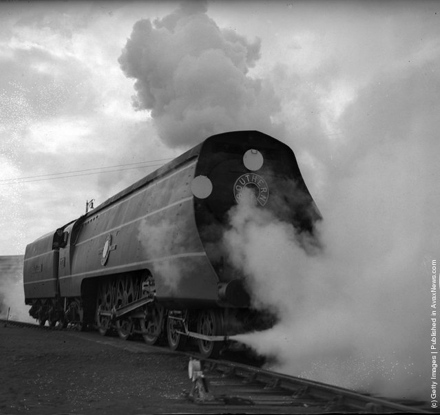 1941: Dressed in an engine driver's cap and overalls, the Minister of Transport, Moore-Brabazon, drove the Southern's new streamlined engine, named the 'Channel Packet', on a trial run from its yard