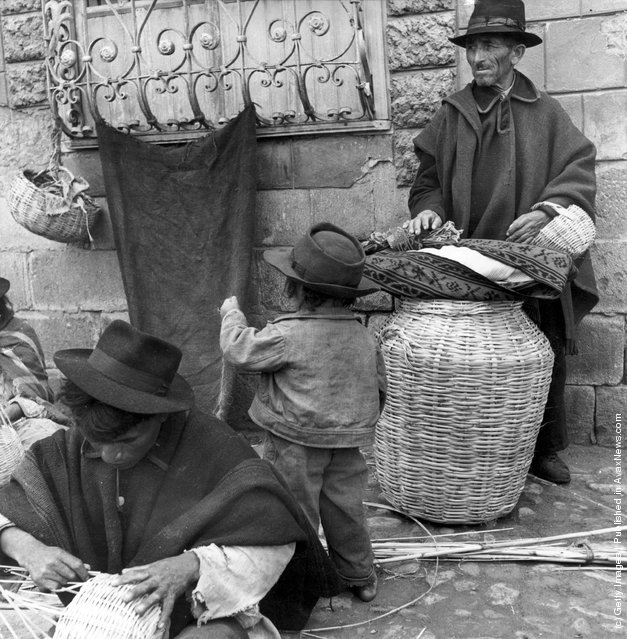 1955: Craftsmen weaving baskets in the Plaza San Alfonso, Riobamba, Ecuador, whilst waiting for customers