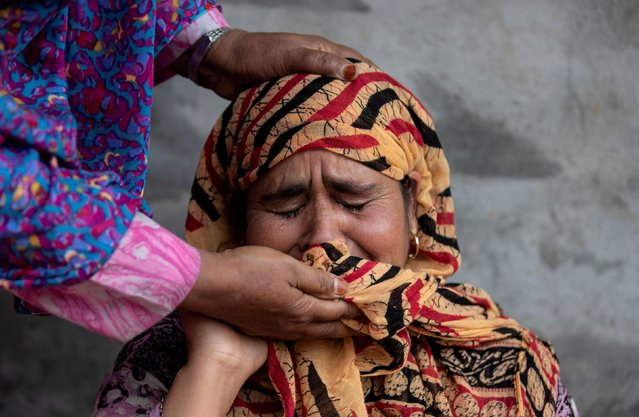 Jameela, mother of Irfan Ahmad Hurrah, who according to relatives was arrested during a clampdown after the scrapping of the special constitutional status for Kashmir by the government, is consoled by a relative as she remembers her son, inside her house in Pulwama, south of Srinagar, August 13, 2019. (Photo by Danish Siddiqui/Reuters)