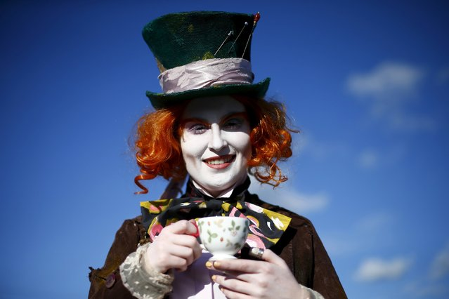"""Ella poses as the Mad Hatter from Alice in Wonderland, outside the MCM Comic Con at the Excel Centre in East London, Britain, in this October 25, 2014 file photo.  It's 150 years since a hookah-smoking caterpillar sitting on a mushroom asked a curious young girl called Alice """"Who are you?"""" and readers have been wondering the same thing ever since. Lewis Carroll's """"Alice's Adventures in Wonderland"""". (Photo by Andrew Winning/Reuters)"""
