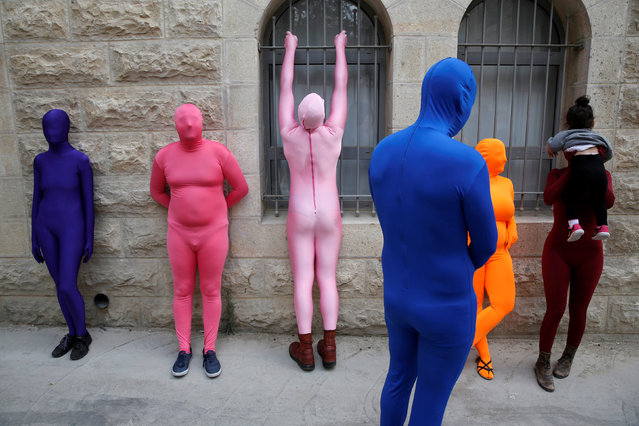 Members of the Prizma Ensemble wearing full solid-coloured bodysuits take part in the 6th Jane's Walk Jerusalem in Jerusalem May 6, 2016. (Photo by Baz Ratner/Reuters)